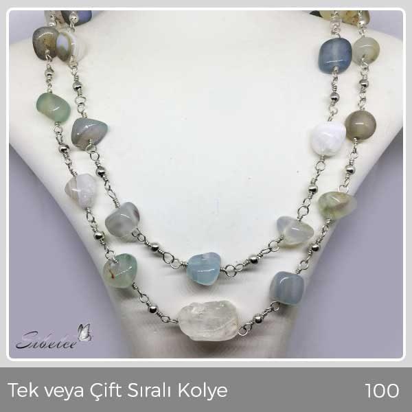 Akik taşlar ve bir adet ham kuvars taş kullanılarak gümüş kaplama tel bükme yöntemiyle hazırlanmış kolye
